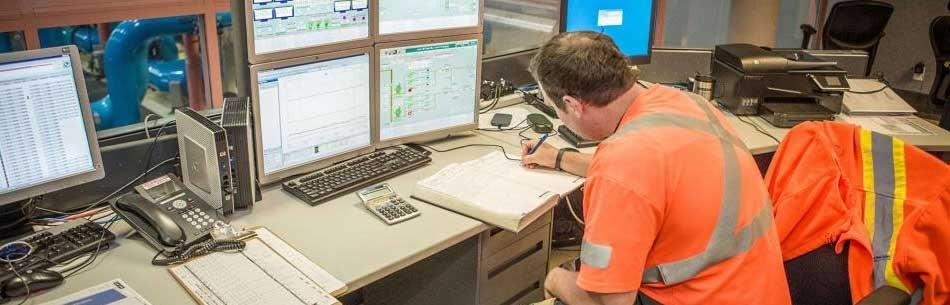 OCWA worker doing paperwork